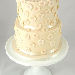 Two tier flower drop wedding cake